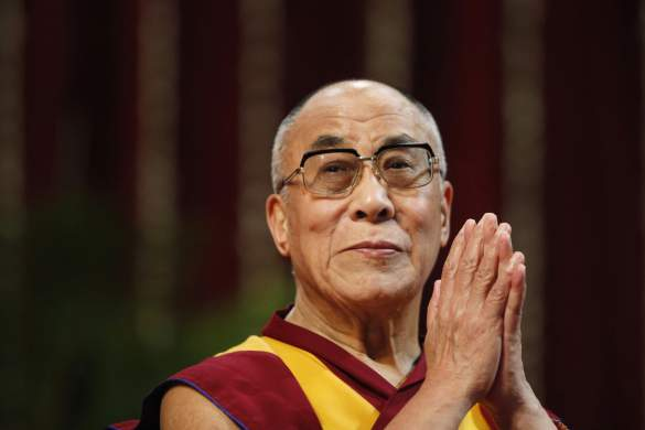 The Dalai Lama gestures before speaking to students during a talk at Mumbai University February 18, 2011. REUTERS/Danish Siddiqui (INDIA - Tags: EDUCATION RELIGION) - RTR2IRAI